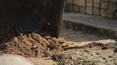 Digger shovels sand, roadworks - stock footage