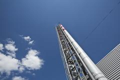Low angle view of distillation tower Stock Photos