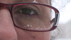 Snow On Eye Glasses Close Up-Shot Stock Footage