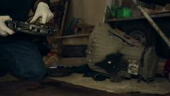 Car mechanic spraying and cleaning replacement parts for a car Stock Footage