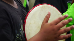Kids playing Malay tambourine, known as Rebana Ubi in wedding ceremony Stock Footage