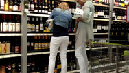 Stock Video Footage of Shoppers in a grocery supermarket. Department of wines.