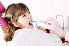 Little girl patient at the dentist Stock Photos
