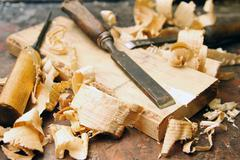 old wood chisels with shavings on the workbench - stock photo