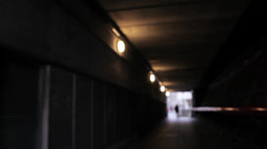 LONDON - Man with a clown mask goes towards the camera in a tunnel Stock Footage