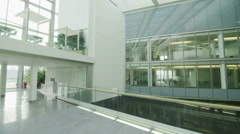 Stock Video Footage of Interior view of modern office building with glass partitions & central atrium