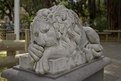 The lion sleeps garden ornament - stock photo