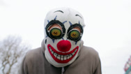 Stock Video Footage of Man with a clown mask in London near Thames River