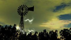 Lightning In Storm Clouds with Rain and Windmill Siluet - stock footage