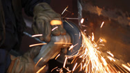 Stock Video Footage of Steel worker grinding in a factory