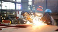 Steel worker welding in metal industry Stock Footage