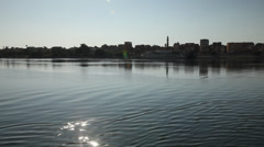 Camera boat Esna city from the Nile River, Egypt Stock Footage