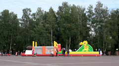 Children jumping on the closed inflatable trampolines. Stock Footage
