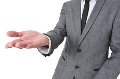 Man in suit with his hand open Stock Photos