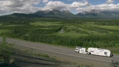 Huge Fancy RV Trailer Passing Along Alaska Scenic Mountain Highway Stock Footage
