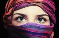 Stock Photo of portrait of beautiful green-eyed woman in hijab