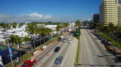 Flyover of the Miami International boat show at Collins Avenue Stock Footage
