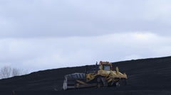 Industrial Bulldozer Pushing Hill of Coal Power Plant Fossil Fuels Excavation Stock Footage