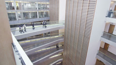 Business people walking along different floors of large modern office building - stock footage