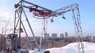 Stock Video Footage of red round wheel under snow rotated on metal elevator, winter details