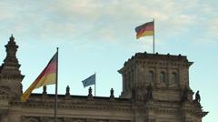 205 Berlin, Reichstag building, German flags on buidling Stock Footage