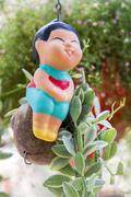 baked clay dolls for decorate garden and house - stock photo