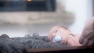 Stock Video Footage of Baby in Crib Looking Back Slow Motion