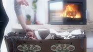 Stock Video Footage of Crib With Baby and Fireplace in Background