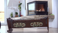 Stock Video Footage of SLOW MOTION: Fireplace Burning With Baby Crib in Front