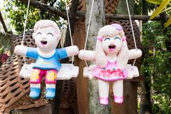 Baked clay dolls for decorate garden and house Stock Photos