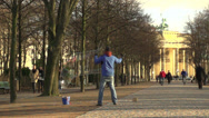 Stock Video Footage of 197 Berlin, Brandenburg Gate, streetartist with water bubbles, slowmotion