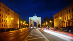 Siegestor triumphal arch in Munich, Germany at night , time lapse Stock Footage