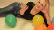 Stock Video Footage of Pretty girl and colorful balloons