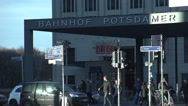 Stock Video Footage of 182 Berlin, Potsdamer Platz, trainstation, traffic, people passing by