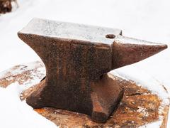 Anvil in old abandoned village smithy Stock Photos