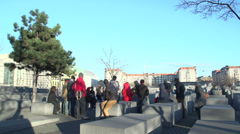 193 Berlin, Holocaust Memorial, tourists with guide Stock Footage