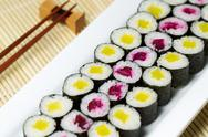 Stock Photo of fresh hand rolled pickled sushi in large white plate