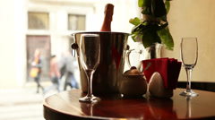 Cute dating scene. Champagne in bucket with glasses. Stock Footage