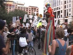 Clown on Stilts at Anti-Globalization Protest in Austin, Texas - stock footage