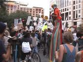 Stock Video Footage of Clown on Stilts at Anti-Globalization Protest in Austin, Texas.