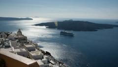 Santorini Fira New Town Pan across sparkling sea with island in distance Stock Footage