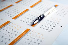 Calendar and pen close-up Stock Photos