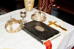 ancient holy bible on old altar. - stock photo