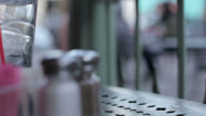 Stock Video Footage of Soft focus shallow DOF setting from bistro table salt and pepper shakers