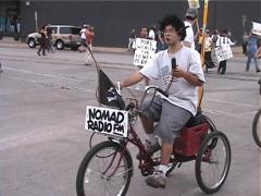 Nomad Radio FM at Anti-Globalization Protest in Austin, Texas Stock Footage