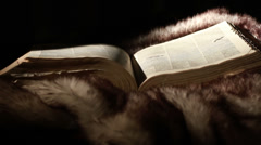 0371 Ancient Giant Book Sitting on Fur - stock footage