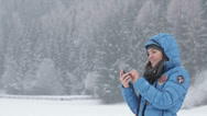 Stock Video Footage of Attractive woman texting with her phone in winter scenery, outdoors HD