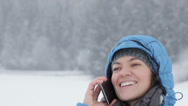 Stock Video Footage of Attractive woman talking on cellphone in winter scenery HD