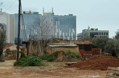 abandoned neighborhood and modern buildings - stock photo
