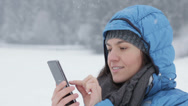 Stock Video Footage of Attractive woman texting with her phone in winter scenery, slow motion HD